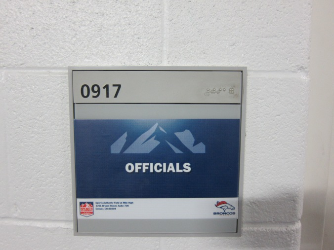 Officials' locker room sign