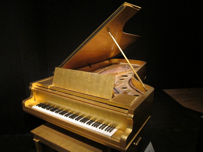 Elvis Presley gold piano