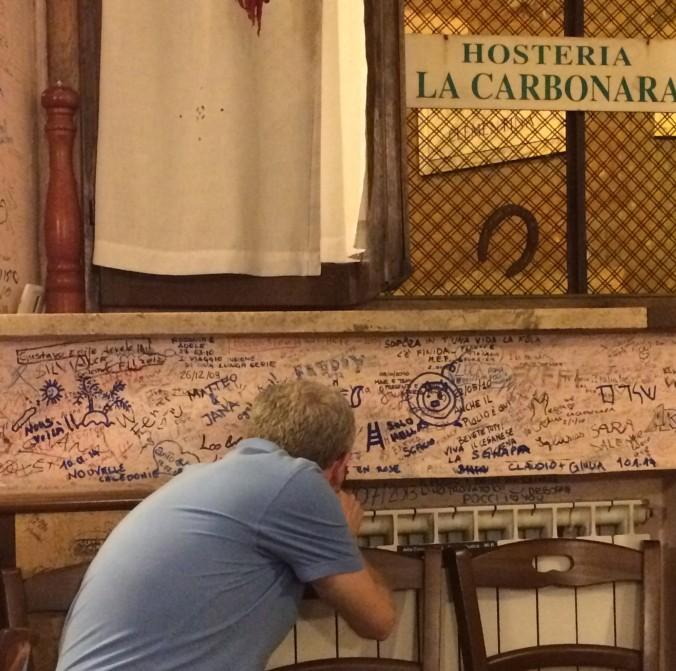 Signing the wall at La Carbonara