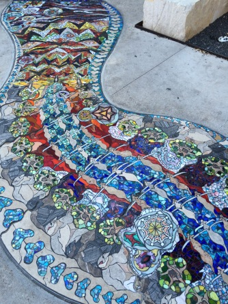 Sidewalk mosaic outside the JW Marriott hotel